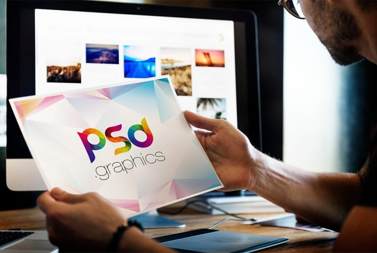 Man Holding Photo Mockup Free PSD