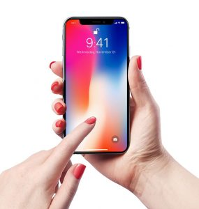 Women Holding iPhone X Mockup PSD