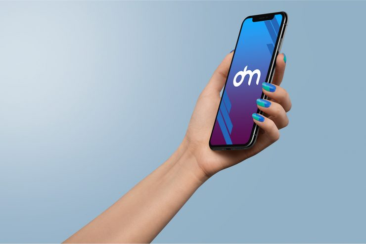 Holding iPhone Xs in Hand Mockup