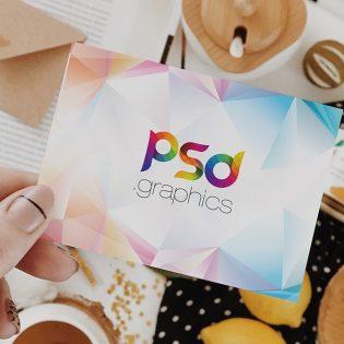 Female Holding Postcard Mockup PSD