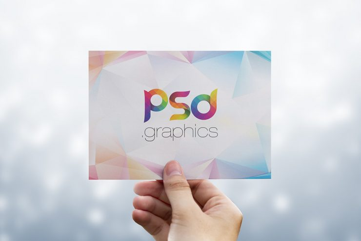 Holding Postcard in Hand Mockup Template