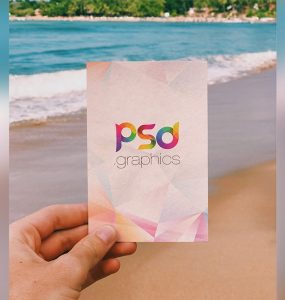 Holding Post Card in Hand Mockup