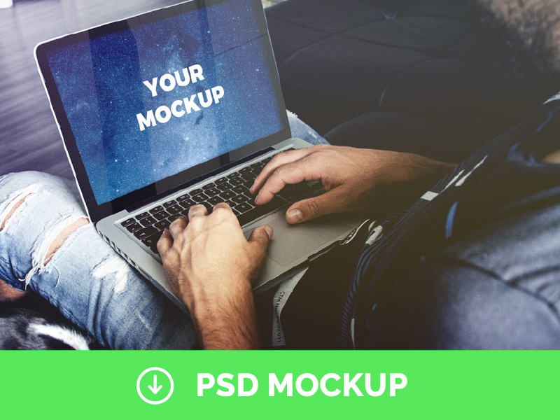 Man Holding Macbook Pro Free PSD Mockup