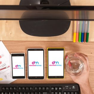 Window smartphones on table free PSD mockups