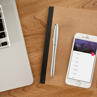 iPhone 6 on Desk Photo Mockup Free PSD