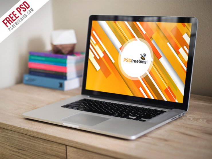 Macbook Pro on Wooden Table Mockup PSD