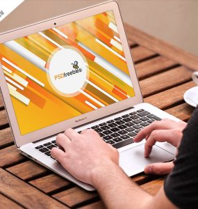 Man Working on Macbook Mockup PSD