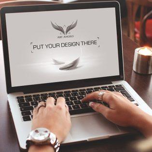 Working on MacBook Mockup Free PSD