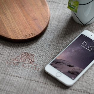White iPhone 6 on Table Mockup Free PSD