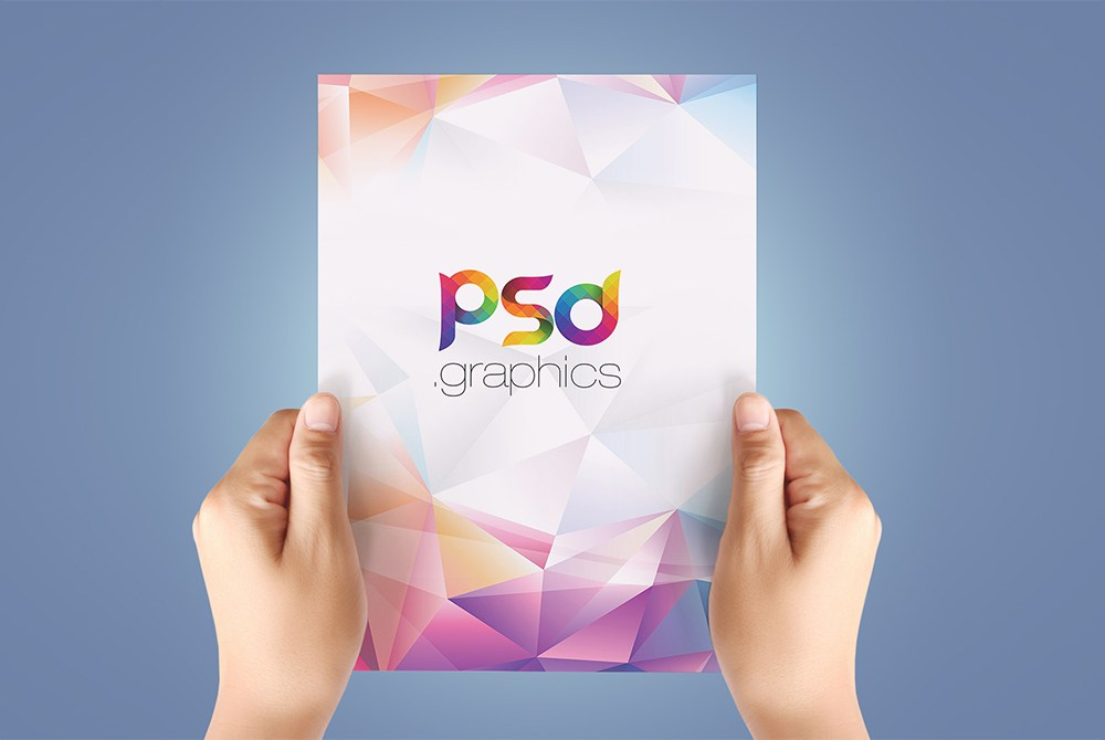 A4 Paper in Hand Mockup Free PSD